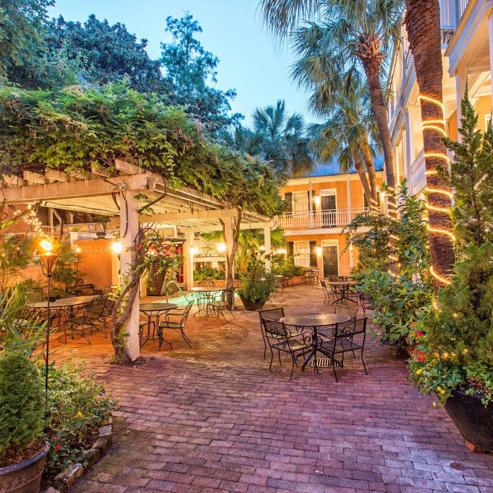 Country Historic Inn Lounge Patio Terrace tree ground property Resort house Village home cottage Courtyard Villa Garden plant stone bushes lined