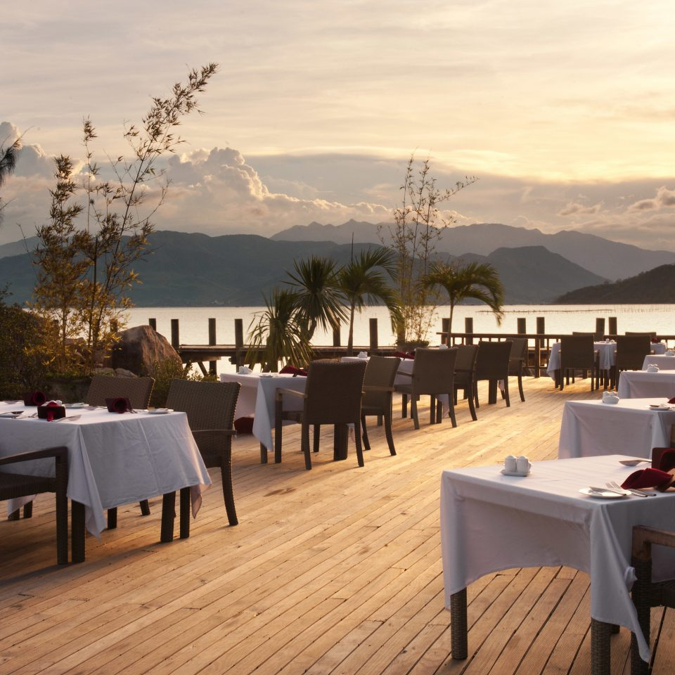 Country Cultural Dining Drink Eat Eco Forest Jungle Luxury Mountains Nature Outdoor Activities Scenic views Tropical Waterfront sky chair restaurant evening Resort overlooking