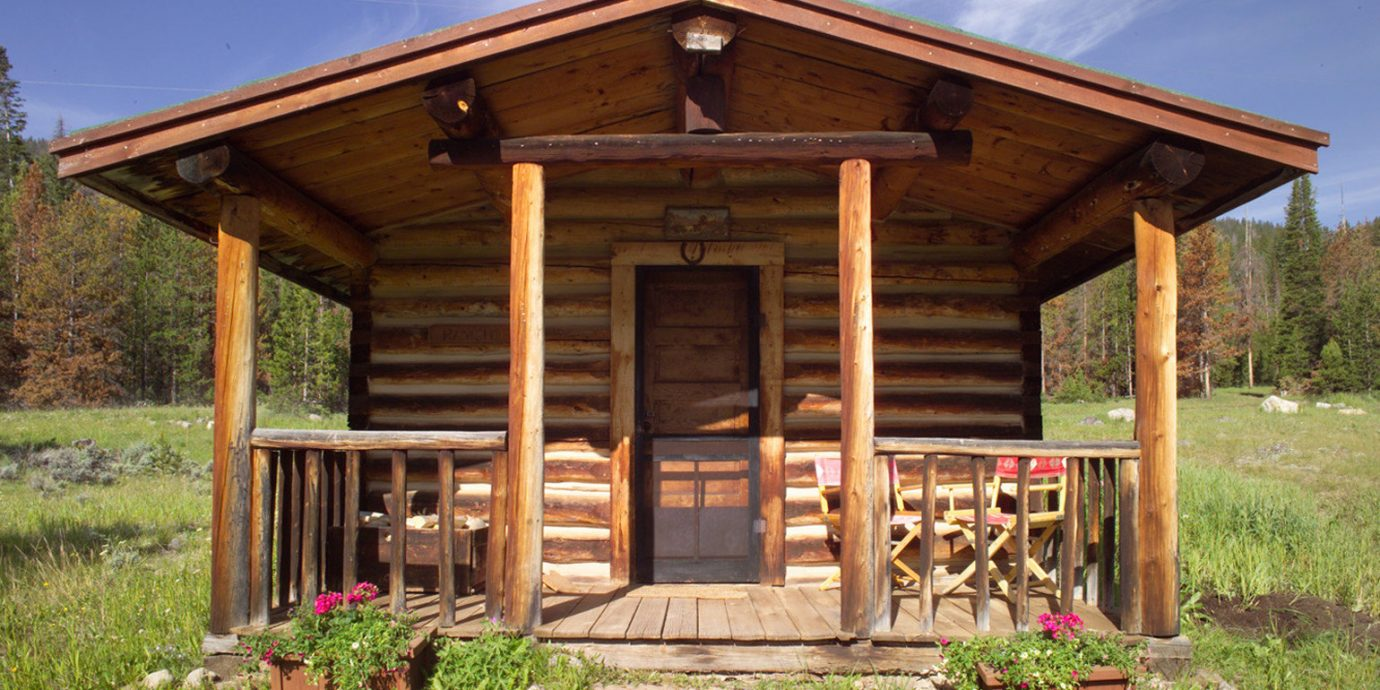 Country Deck Lodge Ranch Rustic grass sky building wooden log cabin gazebo porch house shed hut home outdoor structure cottage shack old pavilion structure Garden roof