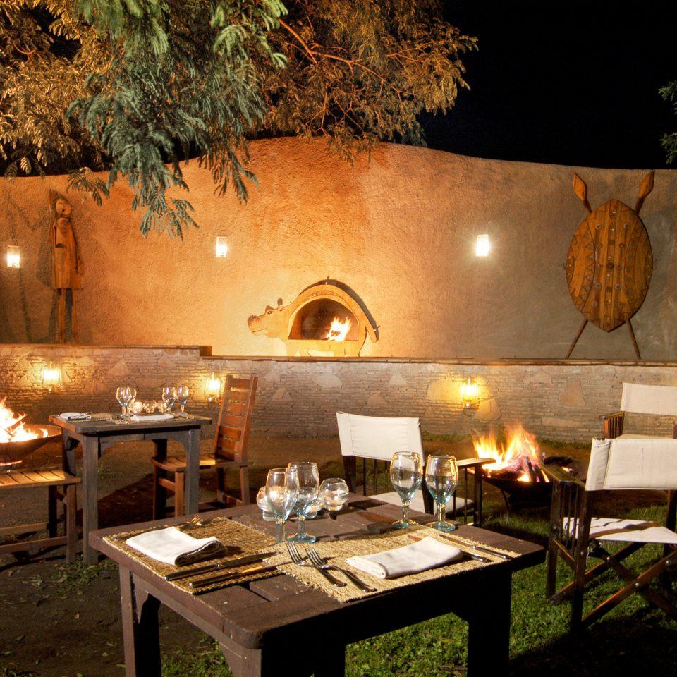 Country Dining Drink Eat Lodge Romantic Safari tree restaurant night lighting cuisine landscape lighting surrounded stone Island