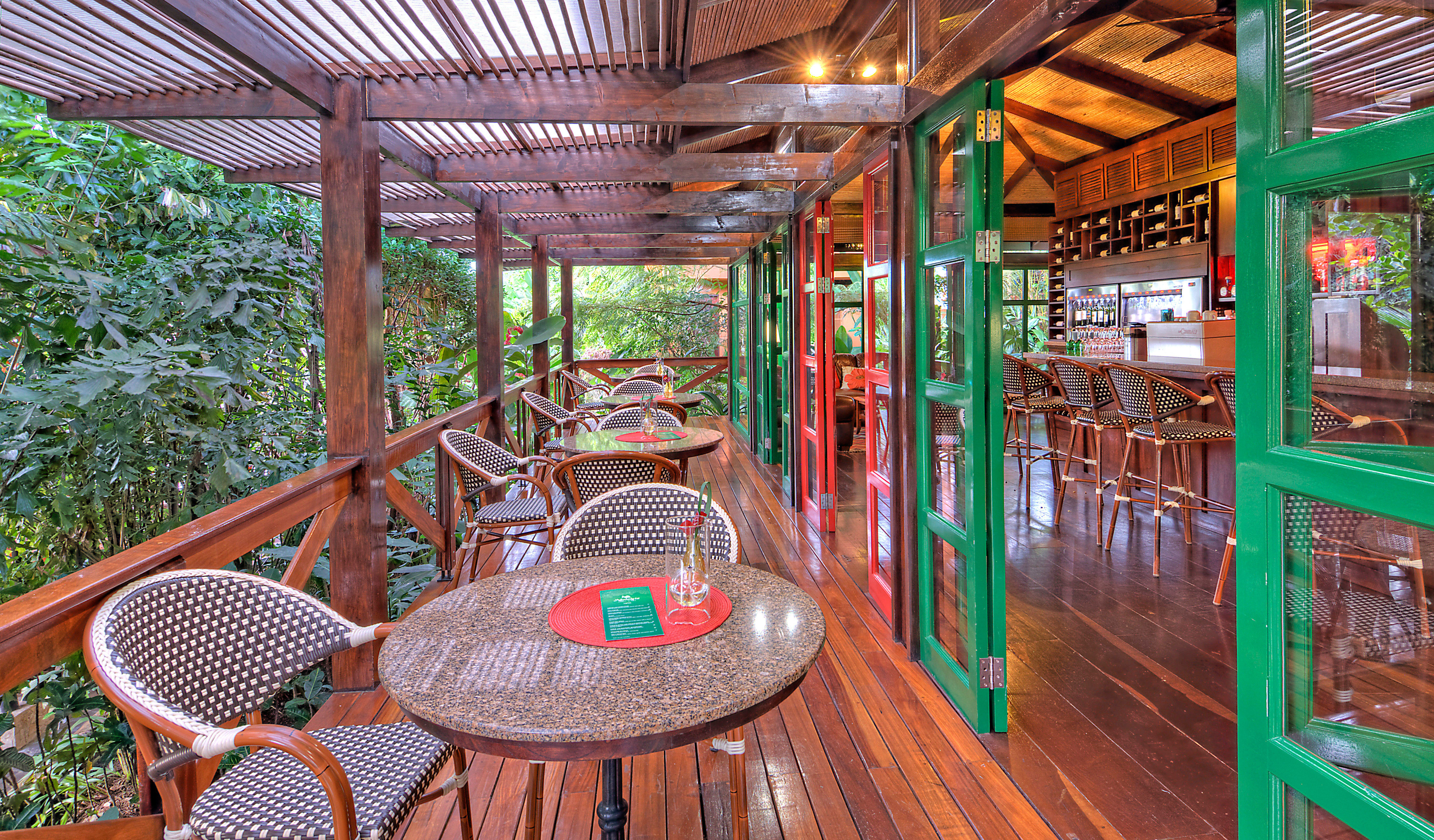 Country Dining Drink Eat Eco Jungle Romantic Rustic Scenic views chair building Resort restaurant outdoor structure amusement park cottage porch
