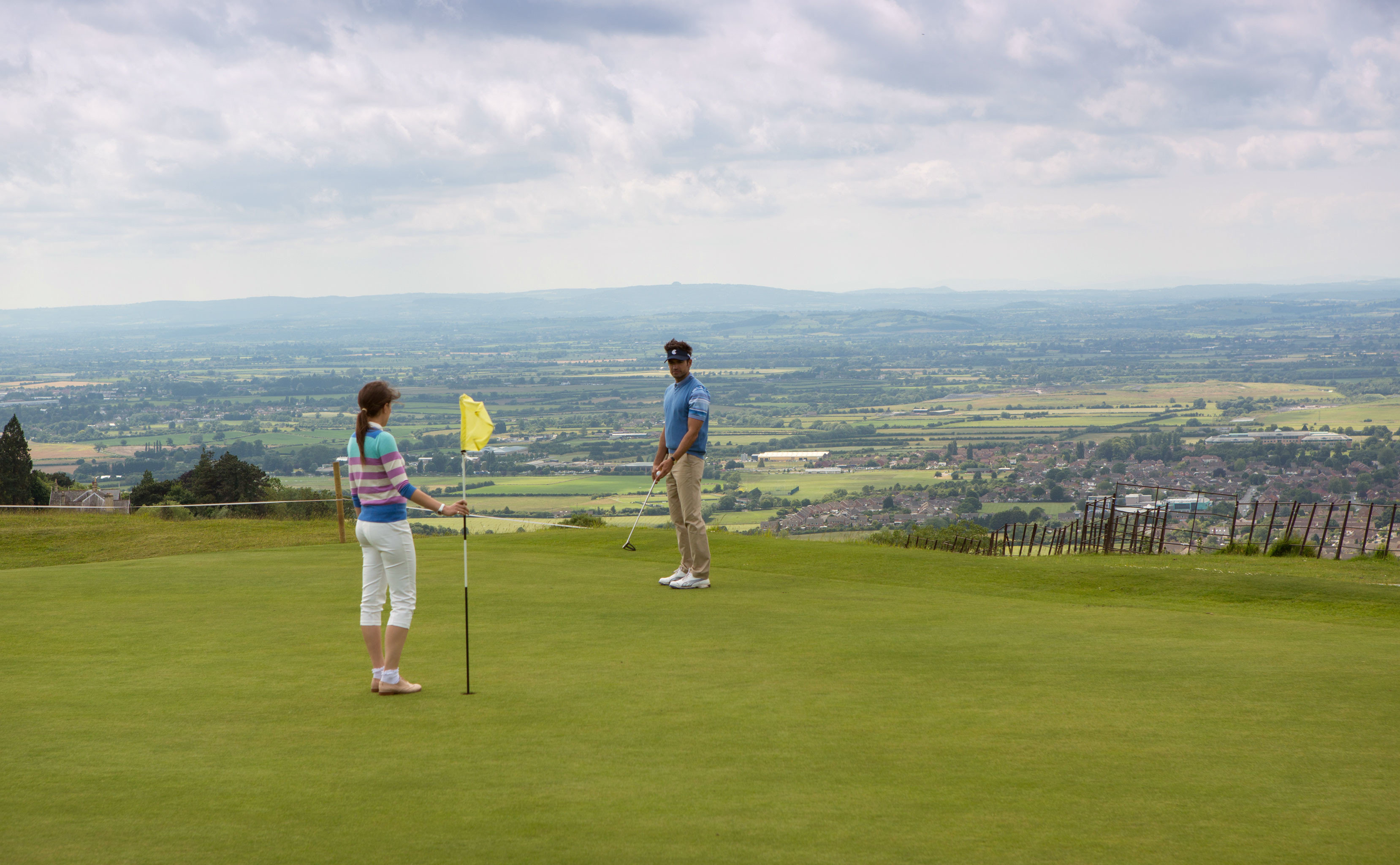 Country Entertainment Golf Grounds Luxury Resort Scenic views Sport sky grass athletic game sports structure field ball game sport venue outdoor recreation recreation golf course individual sports golf club day lush
