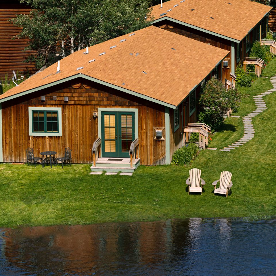 Country Exterior Grounds Lodge Rustic grass house building home log cabin rural area cottage Farm farmhouse hut Village backyard pond old