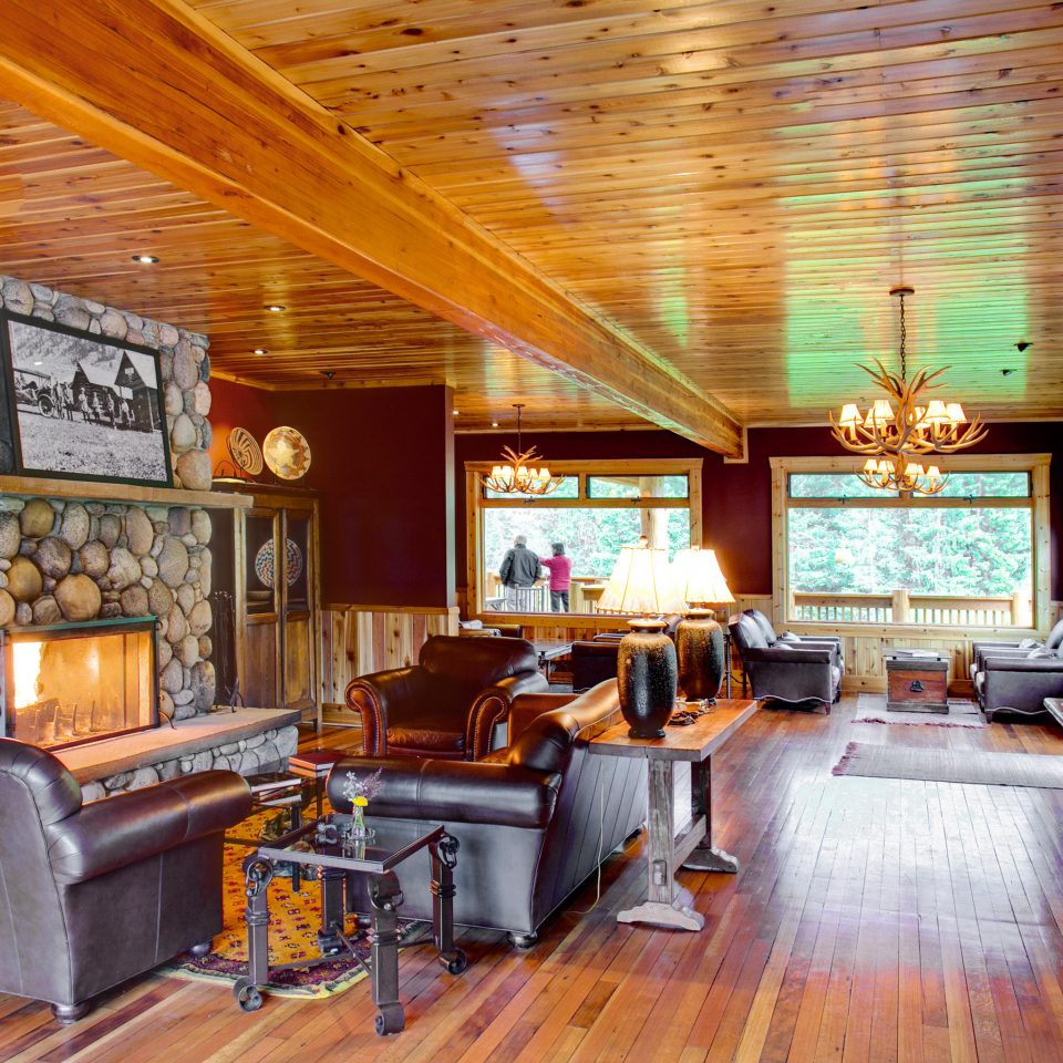 Country Fireplace Glamping Hotels Lodge Lounge Montana Outdoors + Adventure Ranch Rustic Scenic views Trip Ideas property recreation room living room home Lobby cottage mansion log cabin
