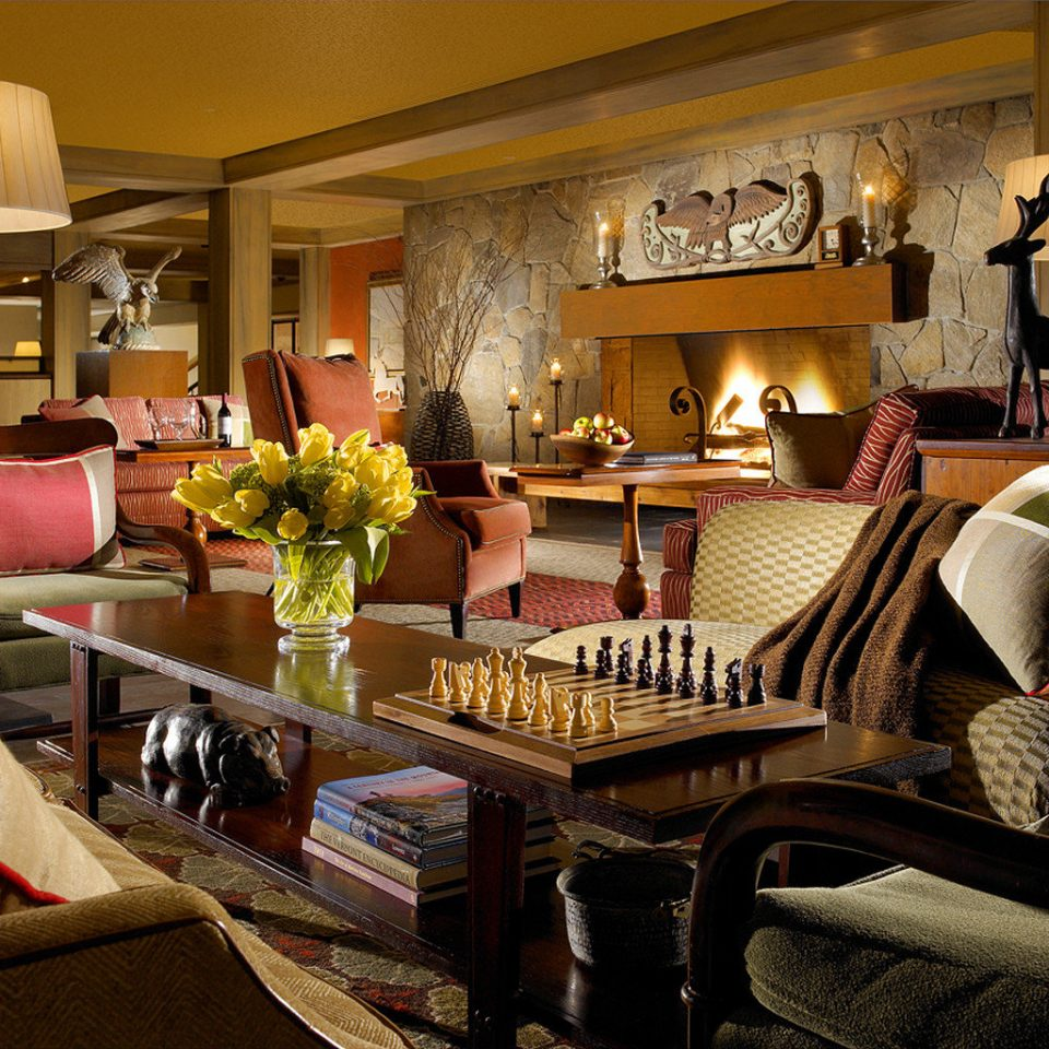 Country Fireplace Inn Lobby Lounge Resort Weekend Getaways living room property home Suite recreation room cluttered