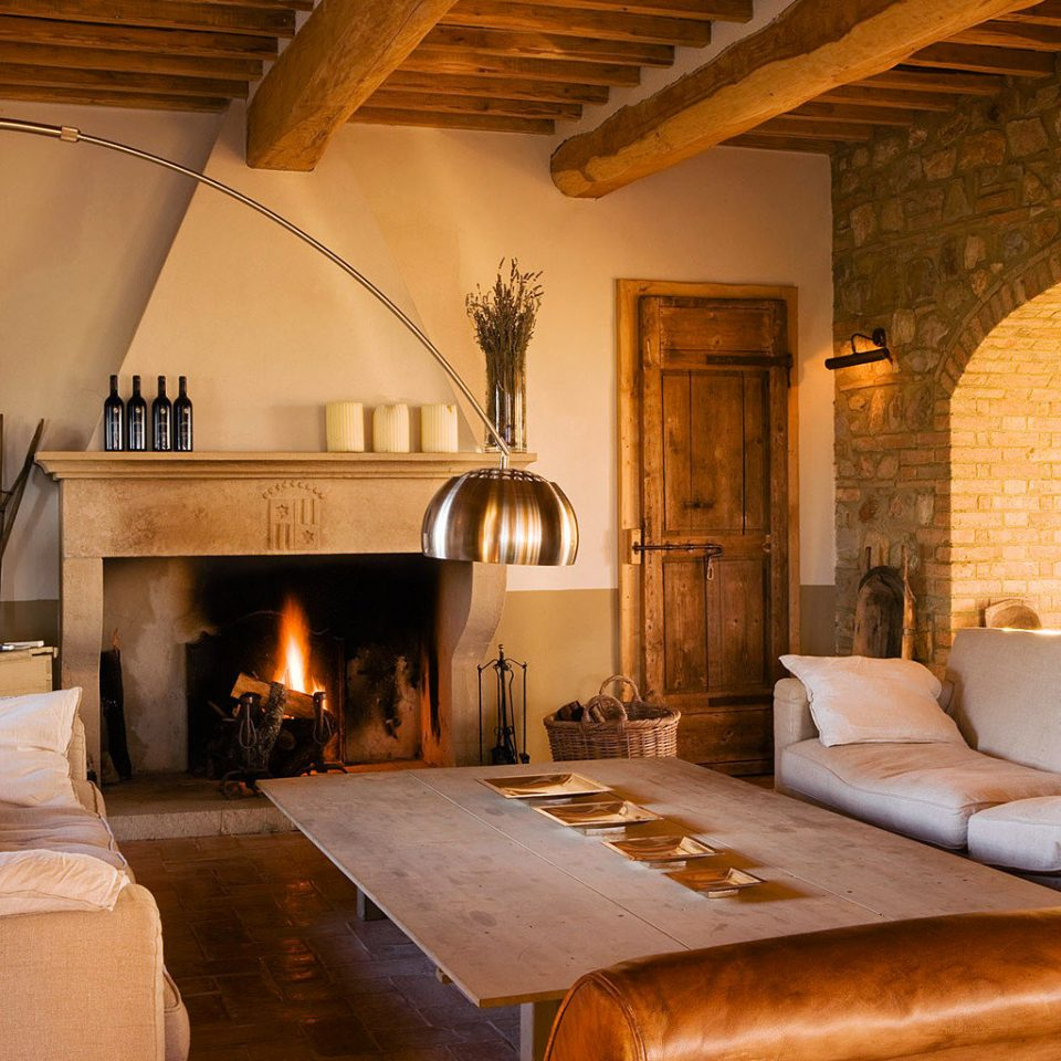 Country Fireplace Lounge Luxury Rustic Wine-Tasting Winery property fire building house living room home hardwood farmhouse old cottage log cabin Villa wood flooring mansion stone