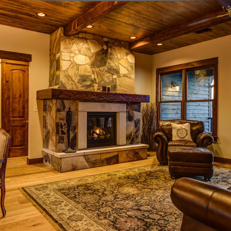 Country Fireplace Luxury sofa living room property home hardwood cottage farmhouse mansion Villa recreation room wood flooring