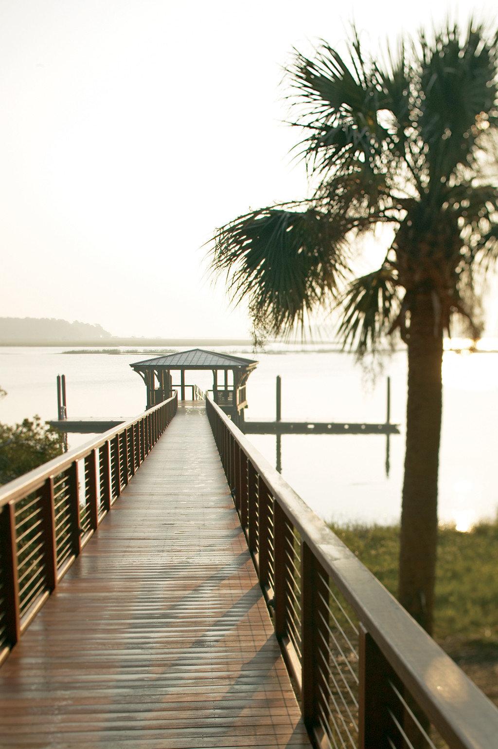 Country Grounds Inn Outdoors Waterfront sky water scene walkway tree boardwalk arecales