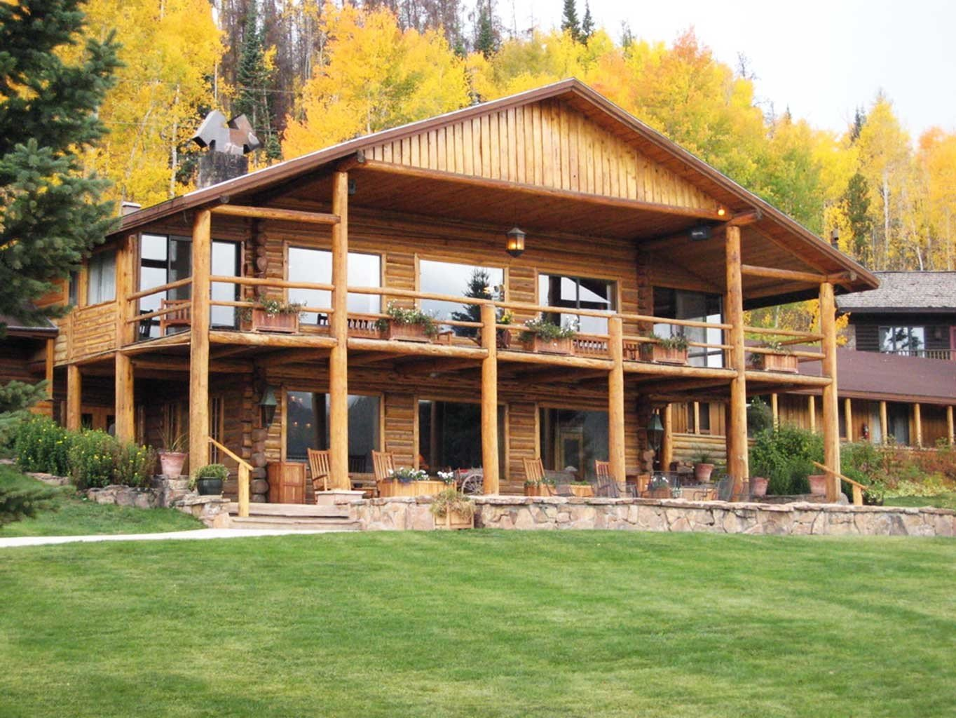 Country Grounds Mountains Ranch Rustic Scenic views grass tree building log cabin property house home cottage lawn outdoor structure pavilion backyard farmhouse