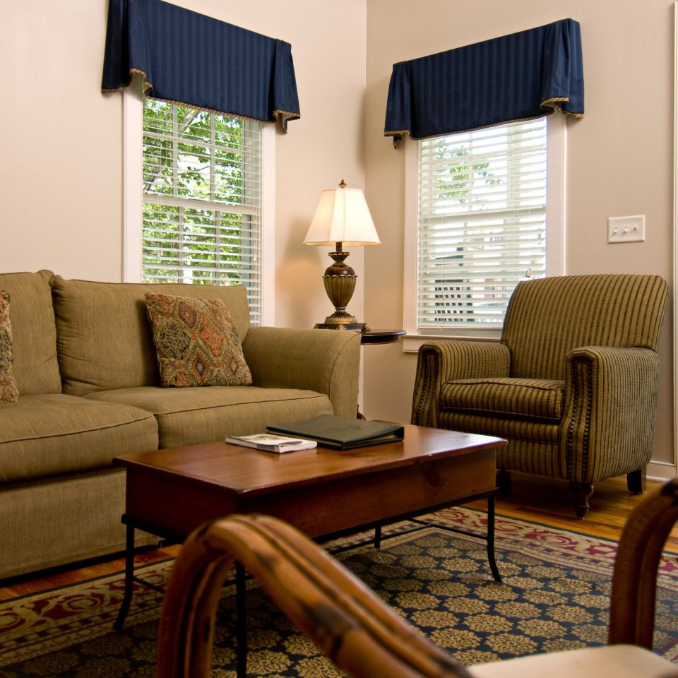 Country Inn Lounge sofa living room property home hardwood condominium cottage seat leather