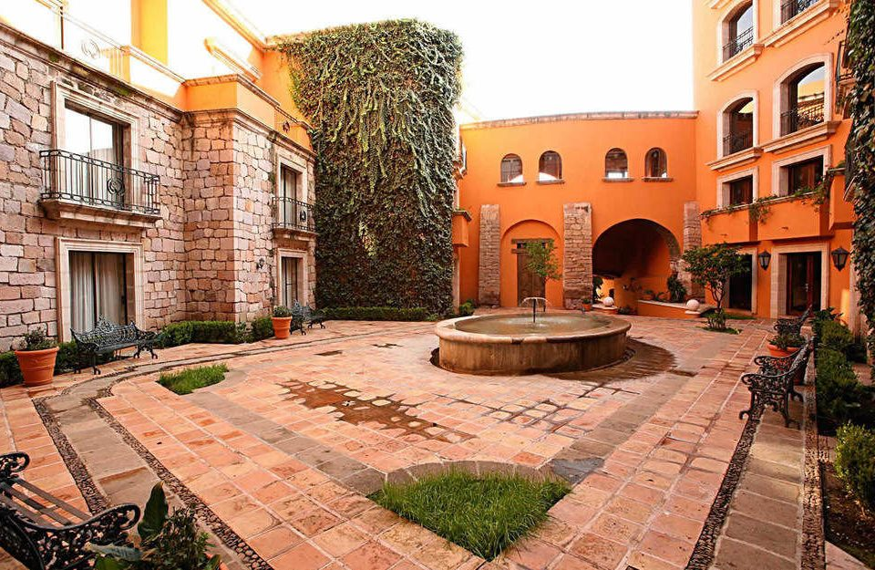 building ground property Courtyard brick stone plaza neighbourhood brickwork home backyard walkway residential area mansion way hacienda outdoor structure sidewalk