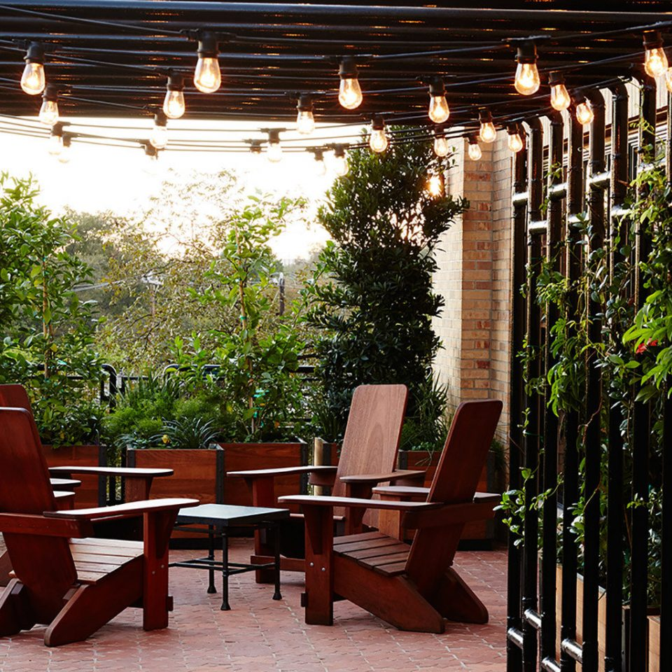 tree chair outdoor structure porch restaurant Courtyard backyard home pergola cottage hacienda