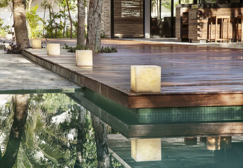 tree swimming pool reflecting pool wooden Courtyard backyard walkway water feature outdoor structure