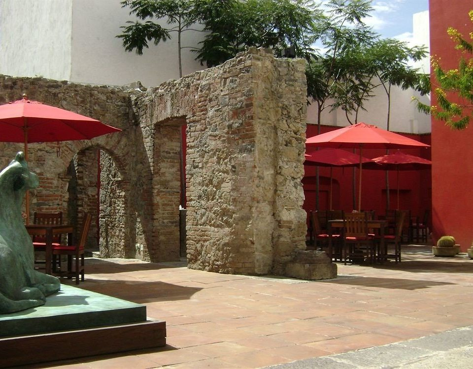building tree red Courtyard hacienda tourist attraction shrine stone