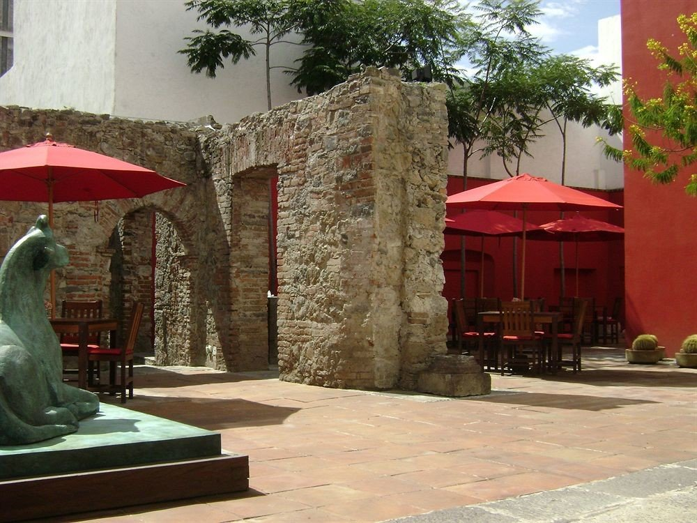 building tree red Courtyard hacienda tourist attraction shrine stone