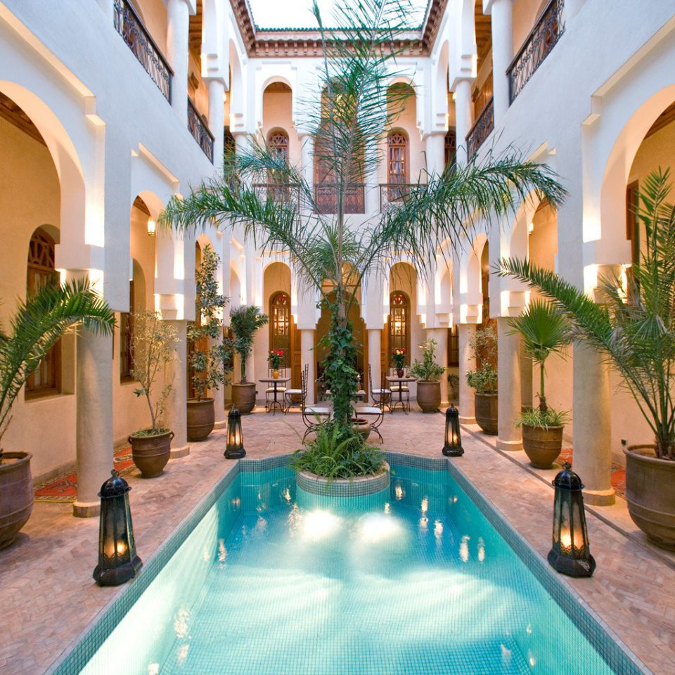 Cultural Lobby property building Resort hacienda swimming pool Villa mansion Courtyard palace