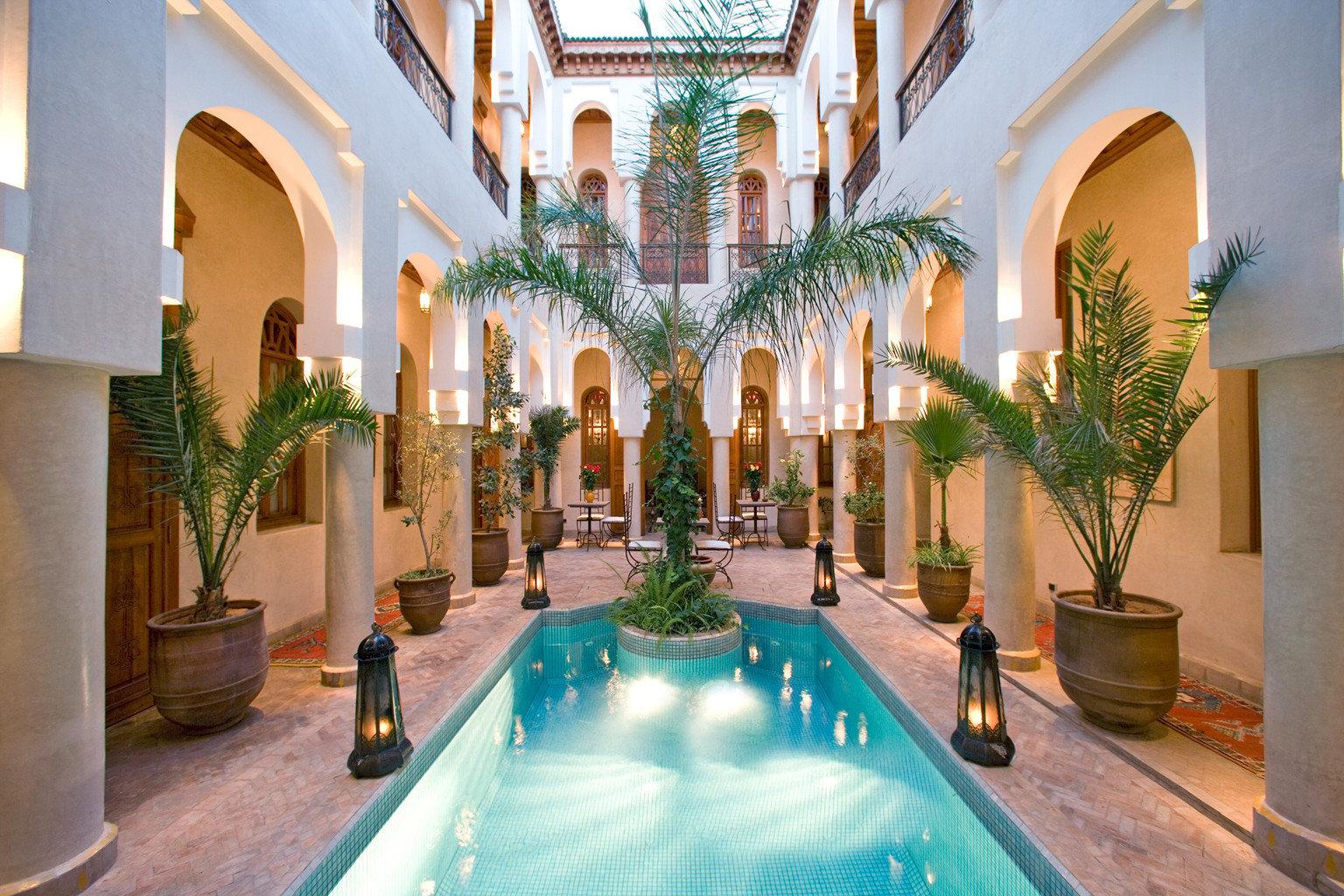 Cultural Lobby property building Resort hacienda swimming pool Villa mansion Courtyard palace