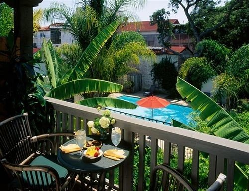 tree property Resort swimming pool chair building backyard porch Villa condominium eco hotel Jungle hacienda Garden Dining mansion cottage Courtyard plant Deck dining table