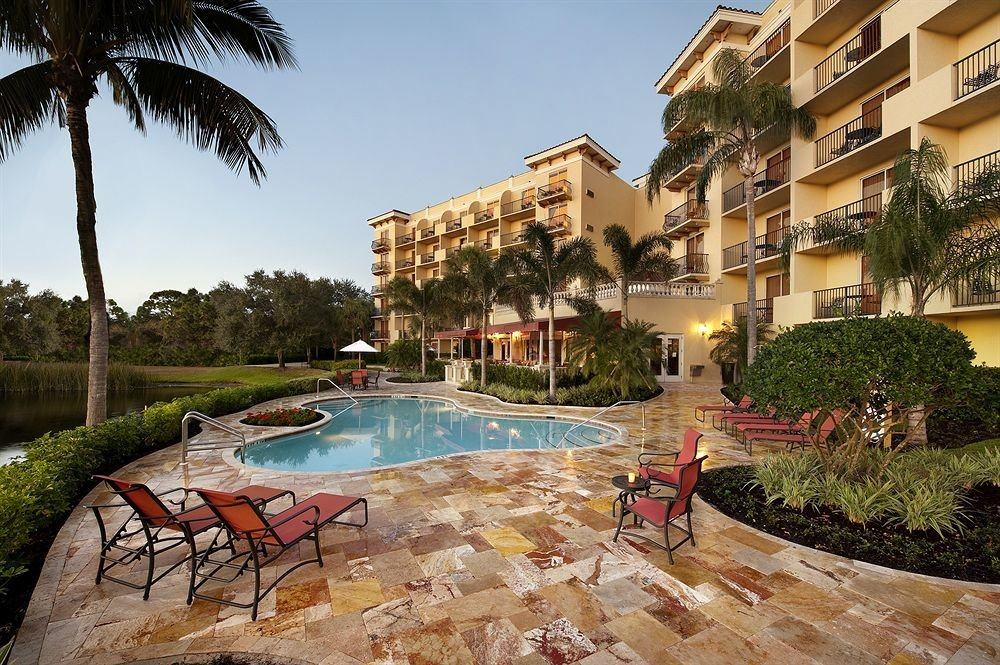 Deck Exterior Grounds Patio Pool Tropical tree building sky Resort leisure property Town swimming pool plaza condominium residential area Village Courtyard town square shore