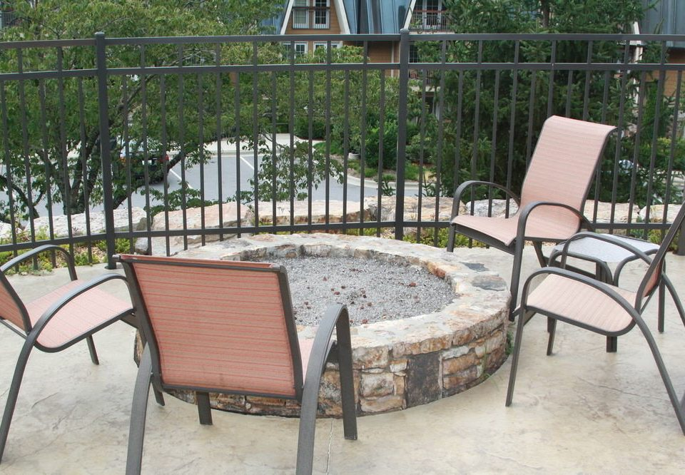 ground chair property outdoor structure backyard Patio wicker yard porch Courtyard cottage Deck