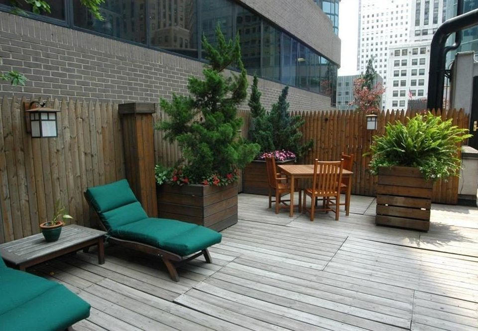 ground property Deck outdoor structure wooden condominium backyard Courtyard porch Patio stone