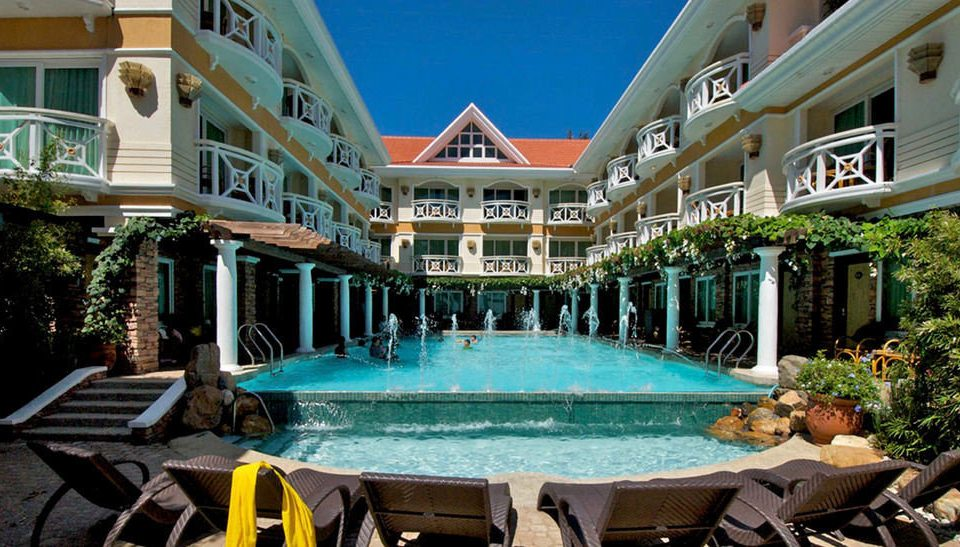 building chair property Resort swimming pool leisure condominium mansion home palace Villa resort town Courtyard backyard Deck