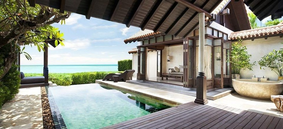 building property swimming pool Villa Resort porch backyard hacienda condominium cottage mansion Courtyard eco hotel outdoor structure Deck stone walkway shade