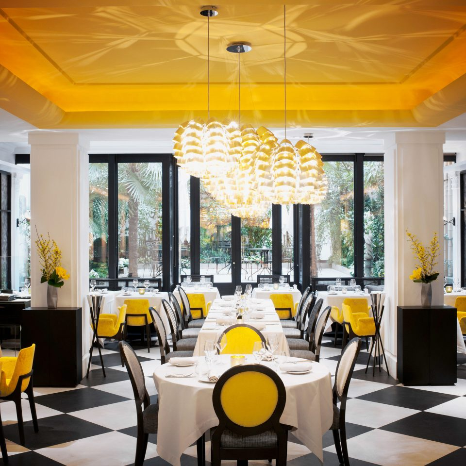 Courtyard Dining Drink Eat Elegant Hip Lounge Luxury Modern property yellow restaurant Resort home condominium living room Lobby function hall Villa