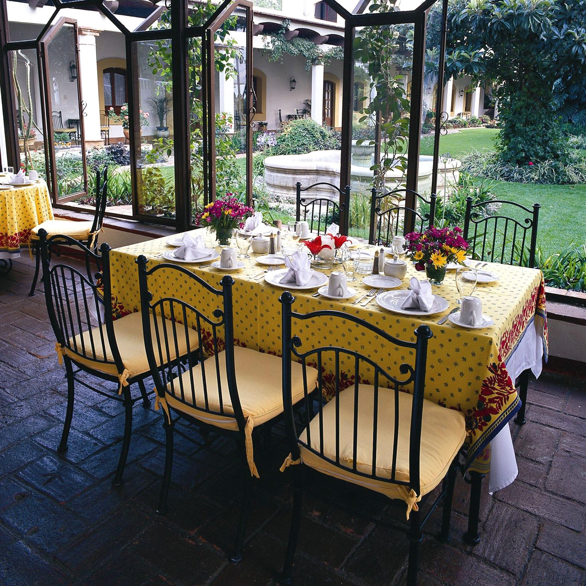 Courtyard Dining Drink Eat Outdoors Patio Terrace chair restaurant backyard flower outdoor structure porch