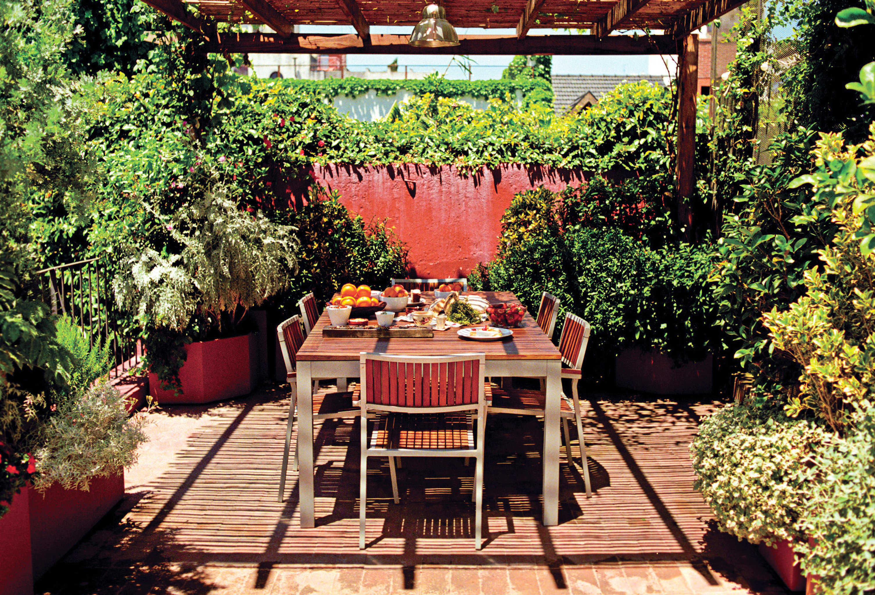 Dining Drink Eat Grounds Outdoors tree ground plant building backyard Garden house yard home Courtyard outdoor structure flower cottage porch restaurant Patio bushes surrounded