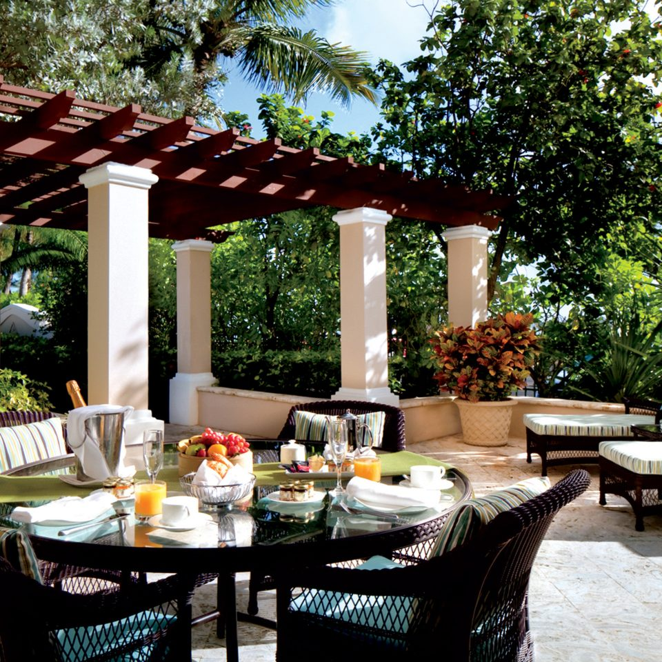 Dining Drink Eat Jetsetter Guides Luxury Outdoors Patio Resort tree backyard restaurant outdoor structure cottage porch Villa Courtyard