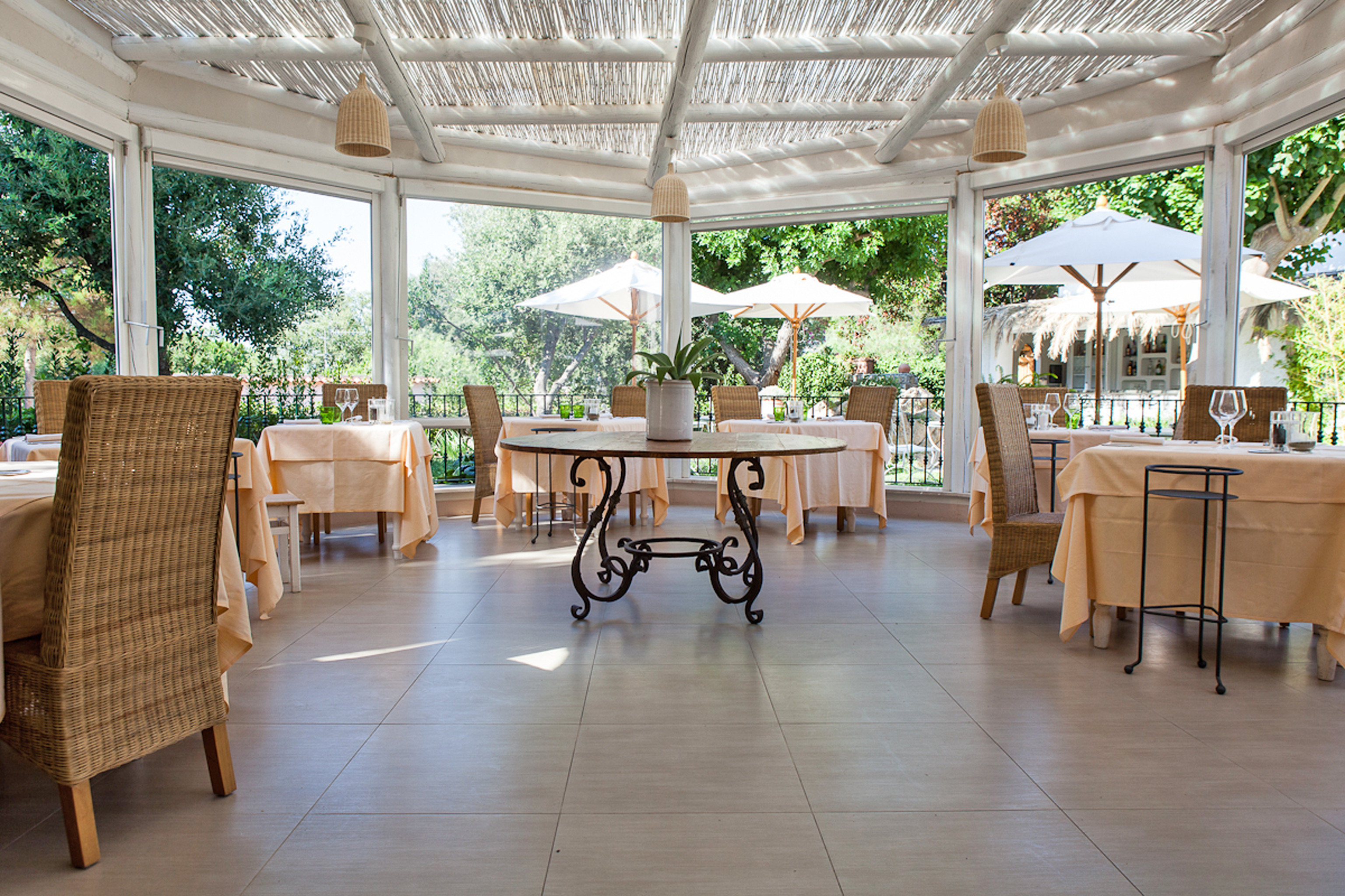 Dining Romantic chair property building Lobby Resort home porch outdoor structure Courtyard flooring restaurant condominium