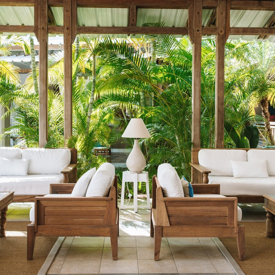 chair property porch backyard outdoor structure Courtyard home Villa restaurant Patio Dining Resort orangery dining table