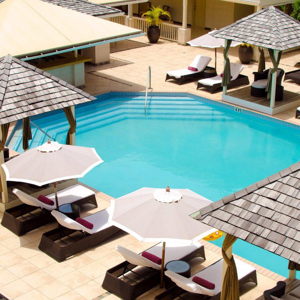 chair leisure swimming pool property Resort backyard Villa outdoor structure Courtyard condominium Dining