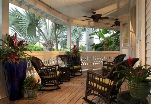 plant property porch home Dining cottage outdoor structure Villa living room backyard Courtyard hacienda condominium Resort dining table