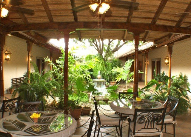 property Resort Villa Dining hacienda outdoor structure plant Courtyard eco hotel restaurant porch cottage backyard roof dining table