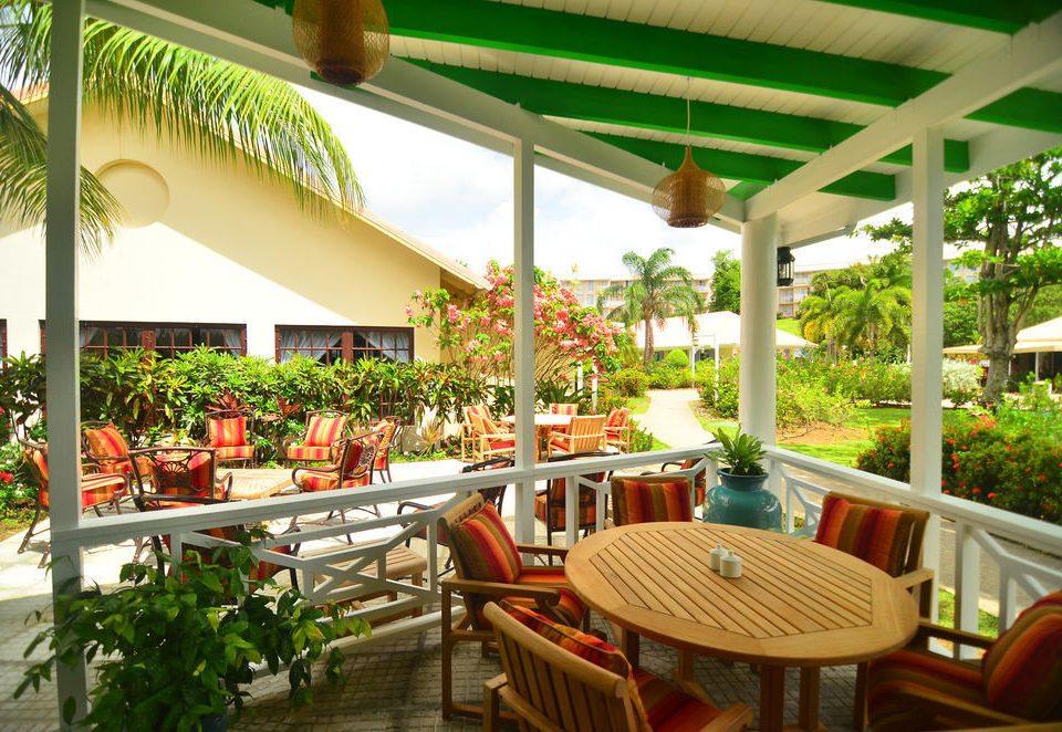 chair property Resort building restaurant porch outdoor structure eco hotel Dining Courtyard condominium hacienda Villa