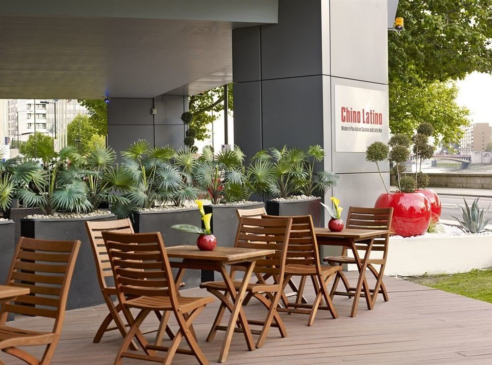 chair property home restaurant outdoor structure Courtyard Dining backyard Villa porch dining table