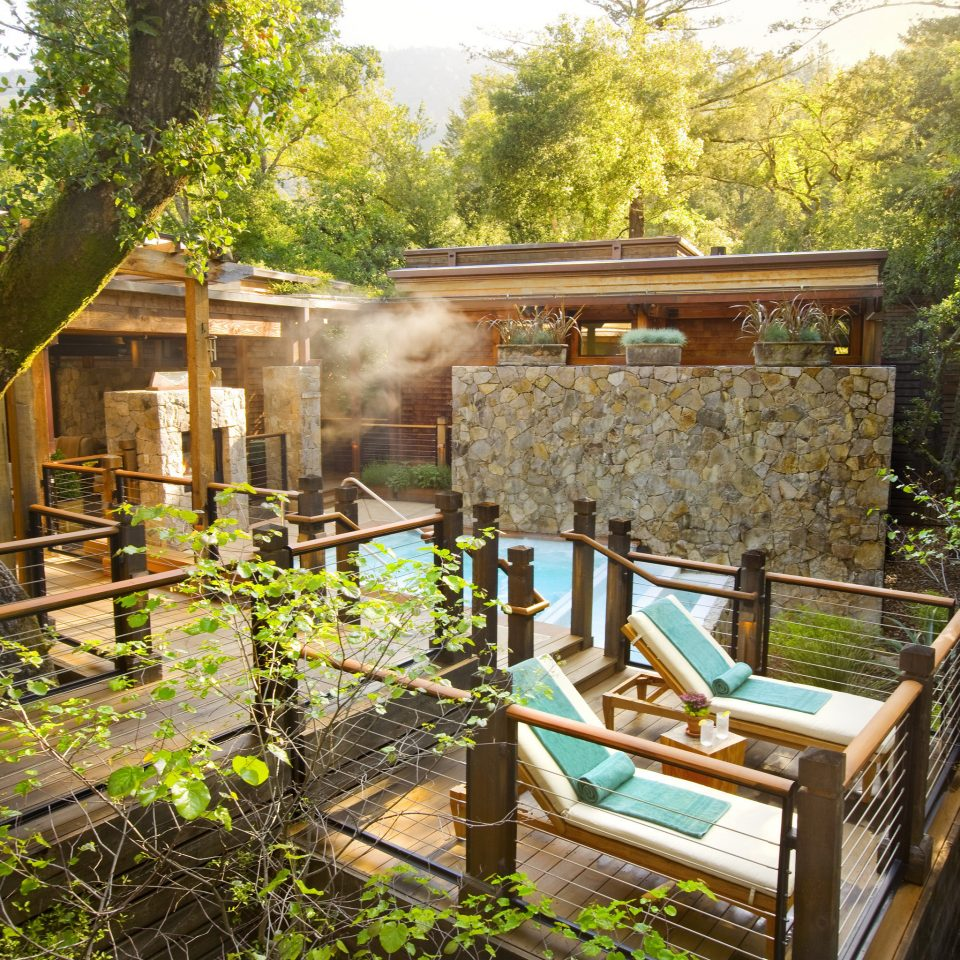 Eco Health + Wellness Hot tub Hotels Luxury Outdoors Ranch Romance Romantic Rustic Spa Retreats Trip Ideas Wellness tree property building house backyard yard cottage home Garden Resort Villa outdoor structure Courtyard porch
