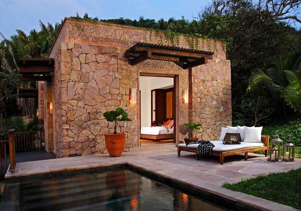 Elegant Lounge Luxury Pool Resort tree property house home Villa backyard cottage brick Courtyard stone hacienda farmhouse outdoor structure