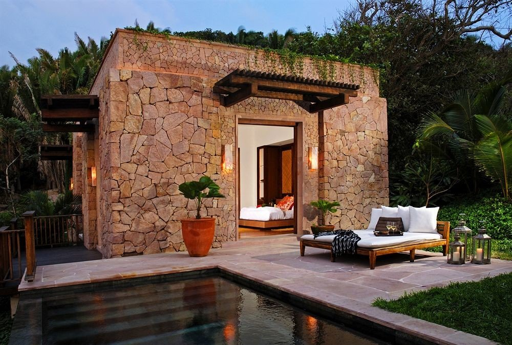 Elegant Lounge Luxury Pool Resort tree property house home Villa backyard cottage brick Courtyard stone hacienda farmhouse outdoor structure