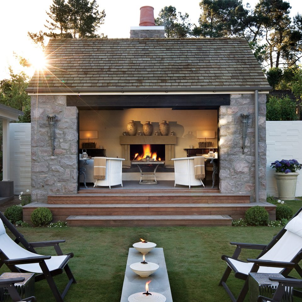 Exterior Fireplace Patio tree grass chair property building home house backyard Courtyard Villa outdoor structure cottage mansion porch farmhouse stone