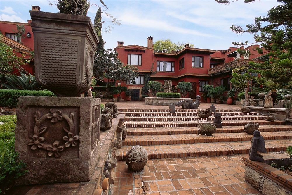 Exterior Grounds Rustic ground sky property stone building temple home Courtyard old ancient history shrine outdoor structure hacienda place of worship Garden cement walkway
