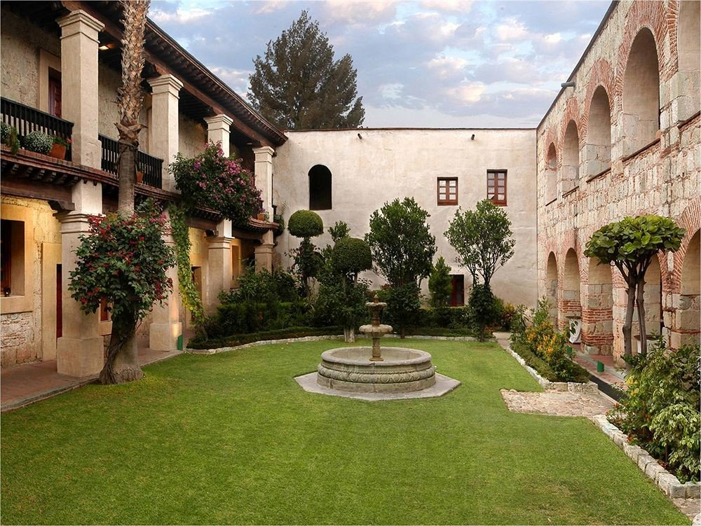 Courtyard Exterior Garden building grass sky house property stone brick neighbourhood home yard lawn backyard residential area mansion hacienda Villa cottage old walkway colonnade