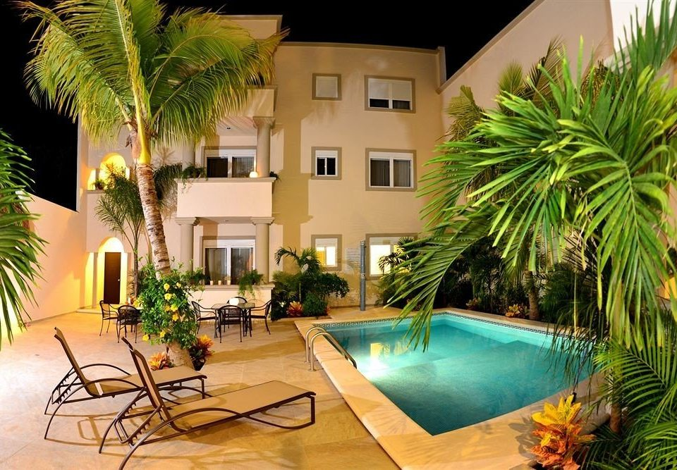 Exterior Grounds Lobby Lounge Luxury Modern tree plant palm swimming pool property condominium Resort home Villa arecales backyard Courtyard hacienda Pool