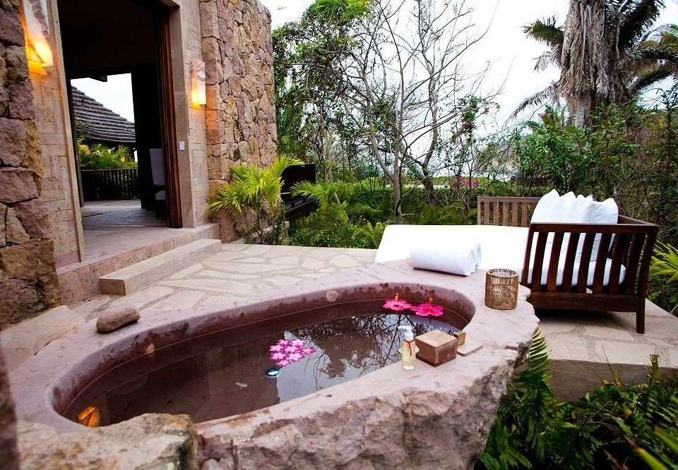 tree stone property backyard swimming pool house Courtyard home Villa yard Fireplace cottage outdoor structure Resort Patio mansion hacienda Garden landscaping