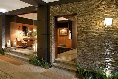 building property Fireplace brick home stone Villa cottage condominium mansion Courtyard living room farmhouse porch