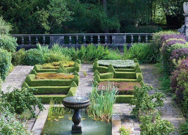 tree Garden plant botanical garden building flower yard grass landscape walkway park landscaping backyard shrub herb Courtyard outdoor structure watercourse houseplant hedge groundcover bushes stone surrounded