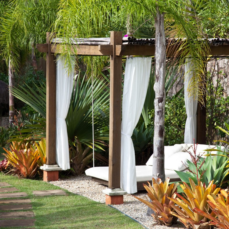tree property backyard botany yard Garden Courtyard outdoor structure home plant cottage flower landscaping stone