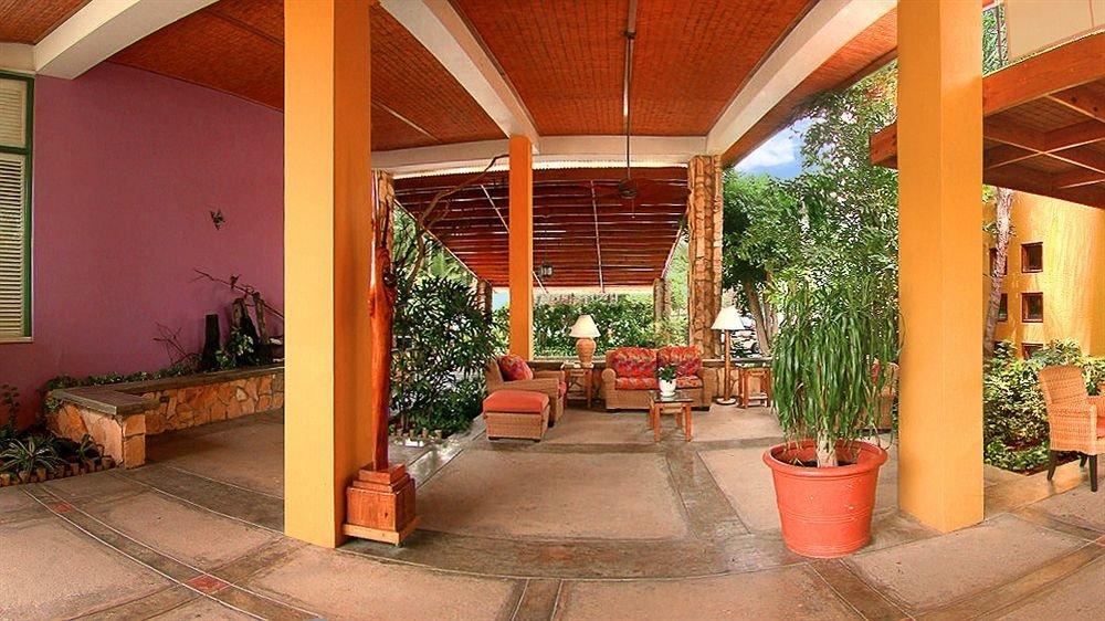 Garden Grounds Lounge Resort ground orange property building Lobby porch Courtyard hacienda home outdoor structure Villa backyard stone
